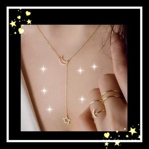 Jewelry - Beautiful gold tone star & moon necklace